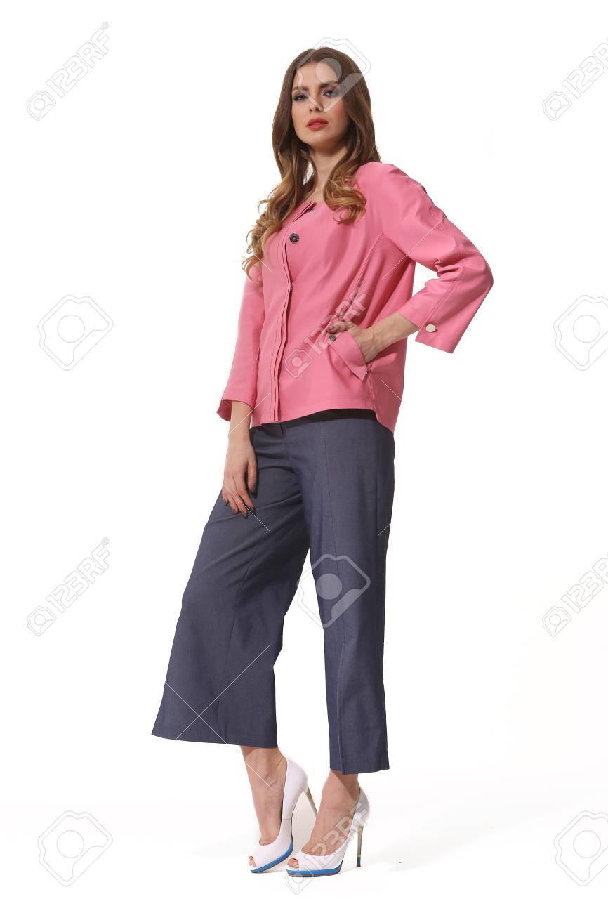 17c00bf2174 Stock Photo - young caucasian business woman executive posing in summer  casual pink jacket and culottes jeans high heels stiletto shoes full body  length ...