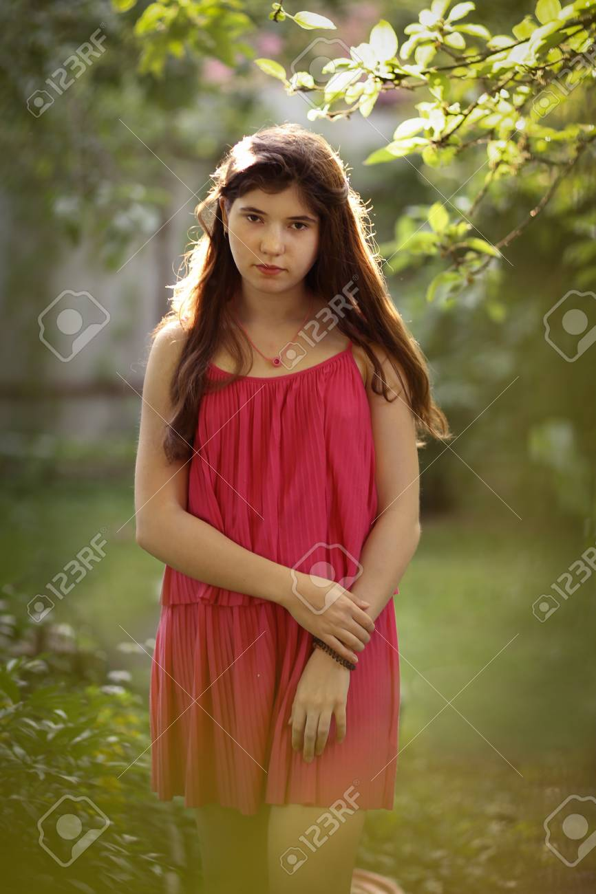 Teenager Girl In Pink Summer Fashion Dress On Green Garden Country