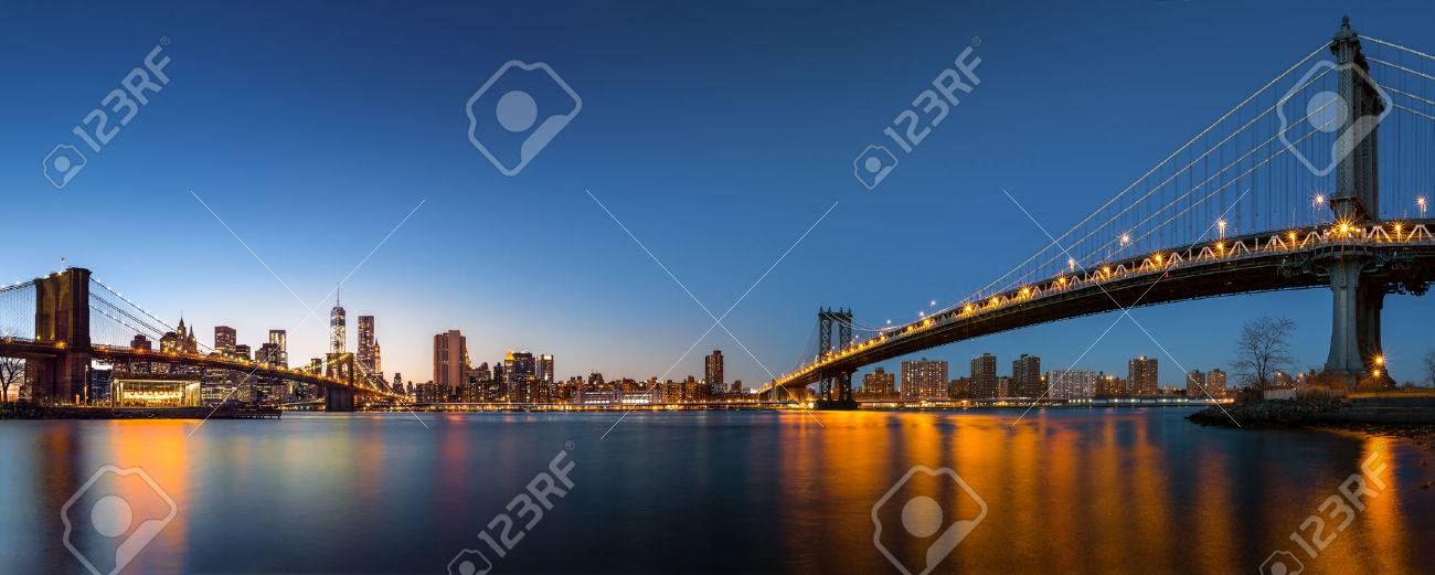 Dusk panorama with the downtown New York City skyline and the Two Bridges Brooklyn Bridge and Manhattan Bridge viewed from Brooklyn Bridge Park, across the East River - 24903684