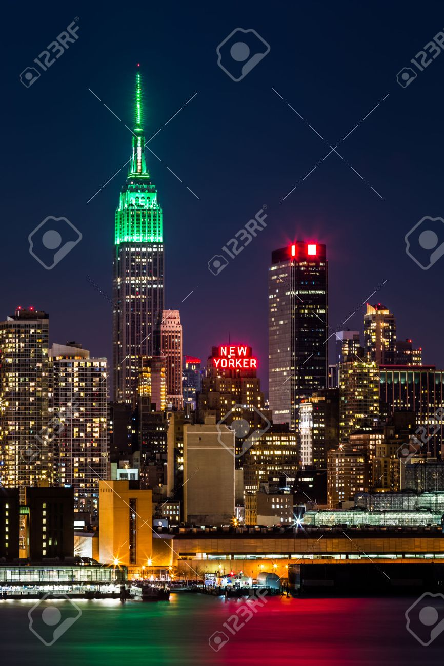 Empire State Building By Night The Top Of Iconic Skyscraper Is Lit In Green