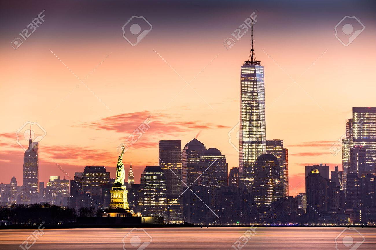 Lower Manhattan with Freedom Tower and The Statue of Liberty at sunrise - 39695485
