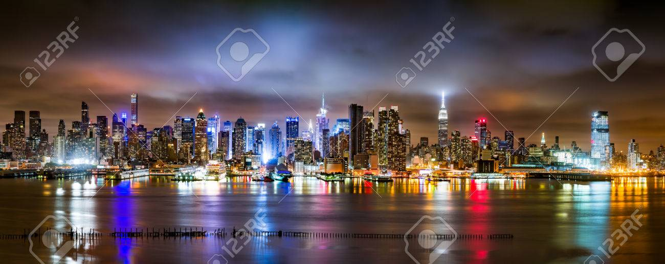 New York City Panorama on a cloudy night as viewed from New Jersey across the Hudson River - 46494451