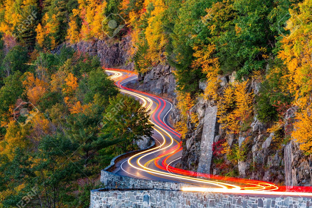 Traffic light trails on Hawk's Nest winding road route 97 in Upstate New York, on an autumn evening. - 46591066
