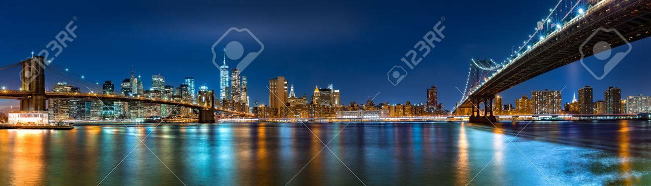 "Night panorama with the downtown New York City skyline and the ""Two Bridges"": Brooklyn Bridge and Manhattan Bridge, viewed from Brooklyn Bridge Park - 50734251"