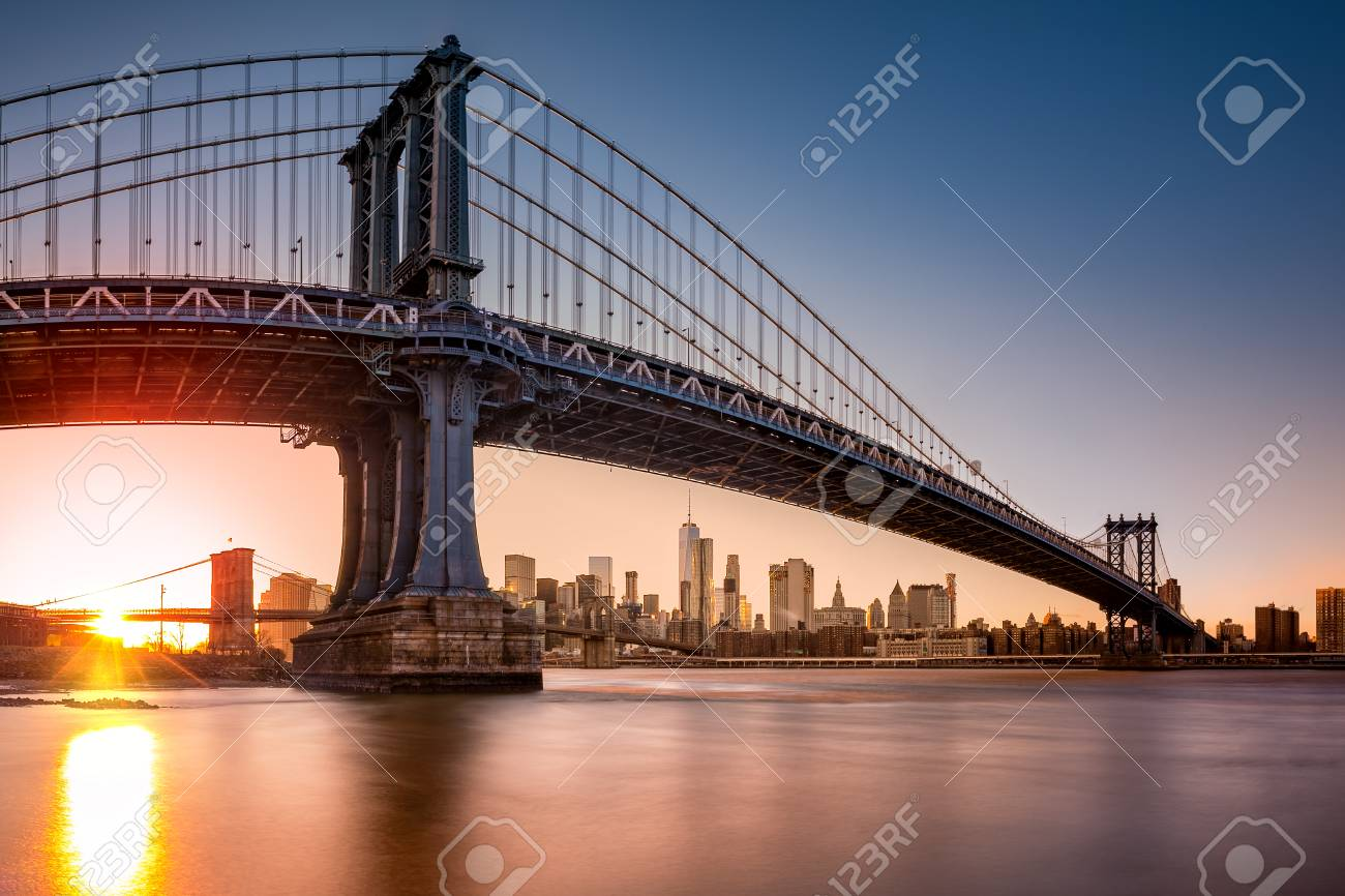 Manhattan Bridge Framing New York Skyline At Sunset. The Use.. Stock ...
