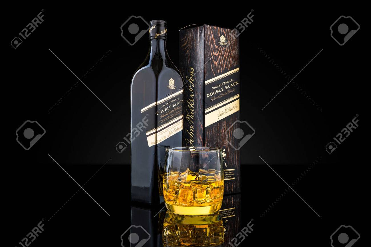 Bottle Box And Glass Of Johnnie Walker Double Black Blended Stock