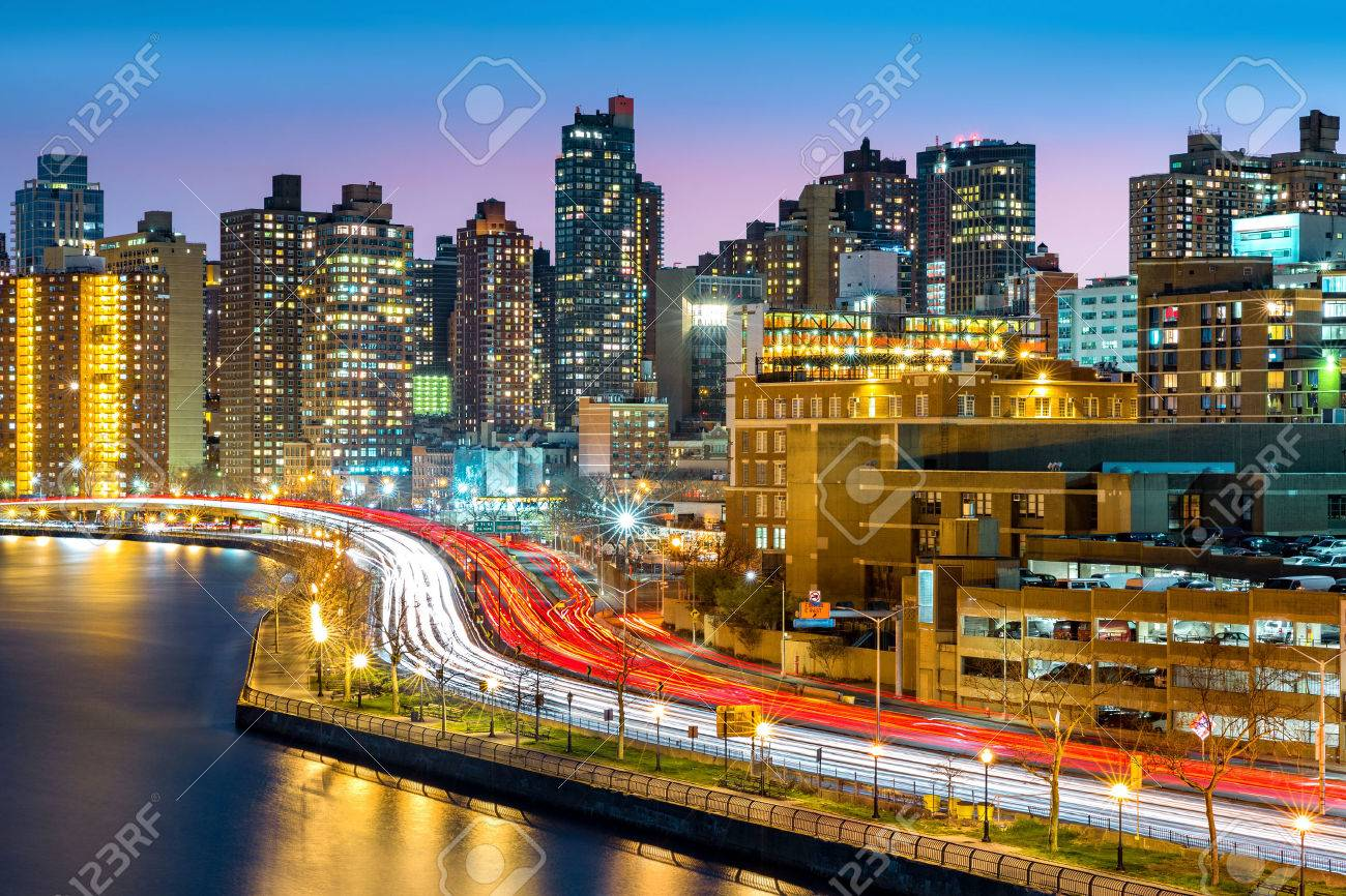 East Harlem neighborhood skyline with rush hour traffic on FDR drive, at dusk, in Manhattan, New York City - 56119681