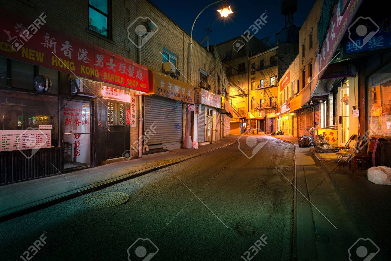 """NEW YORK - JUNE 18, 2016: Doyers Street by night, in NYC Chinatown. The bend became known as """"the Bloody Angle"""" because of numerous gang shootings. - 58937924"""