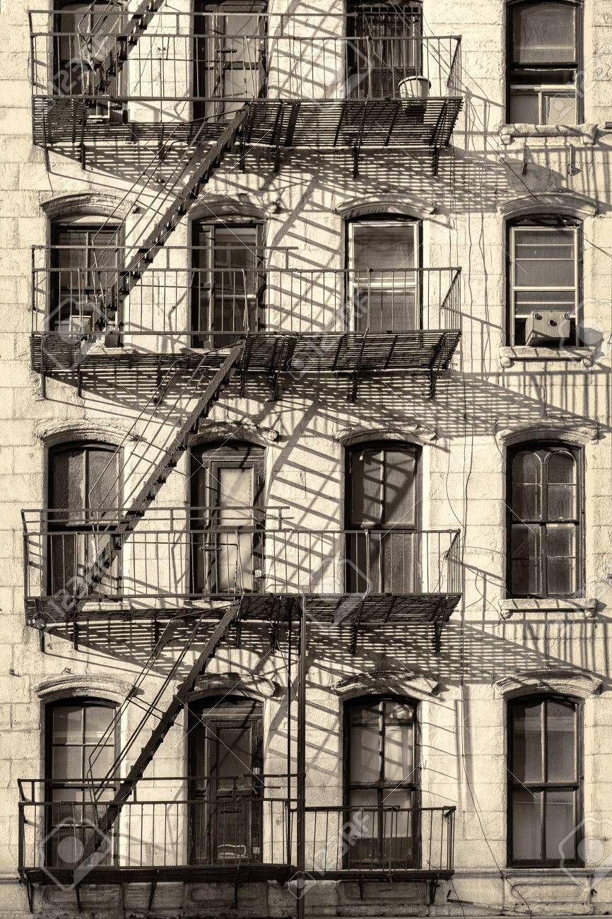 Apartment Building Fire Escape Ladder typical old new york city building with fire escape ladders stock