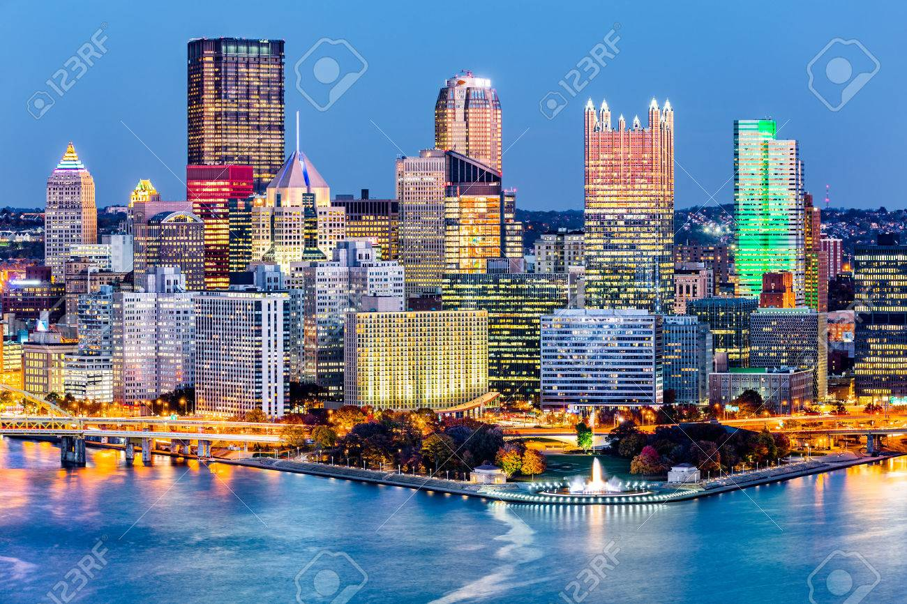 """Pittsburgh, Pennsylvania downtown skyline at dusk. Located at the confluence of the Allegheny, Monongahela and Ohio rivers, Pittsburgh is also known as """"Steel City"""", for its more than 300 steel-related businesses - 66946235"""