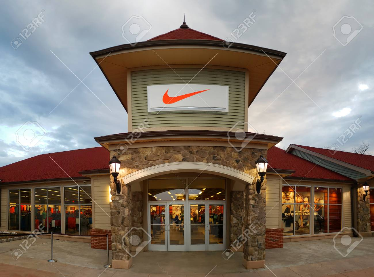 57e8b31f3 CENTRAL VALLEY, NY - MAY 4, 2018: Nike store in Woodbury Common Premium  Outlet Mall. Nike is worlds largest supplier of athletic shoes and apparel  and a ...