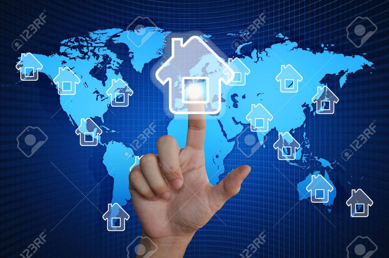 Hand pressing home symbol on world map Stock Photo - 15219277