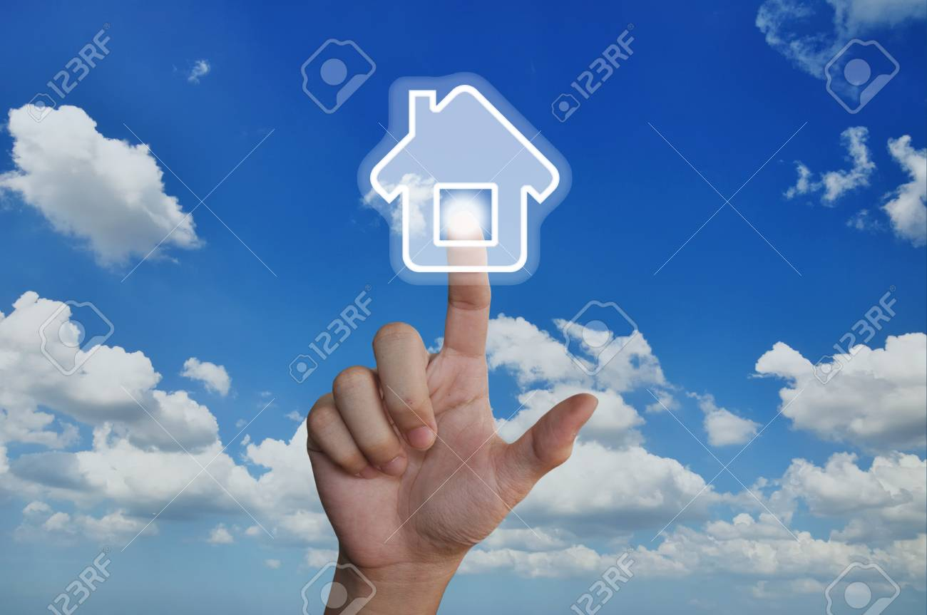 Hand pressing home symbol on blue sky Stock Photo - 15219257
