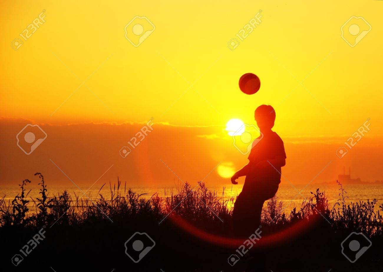 young soccer players at training at sunset - young footballers training nightly at sunset Stock Photo - 10881728