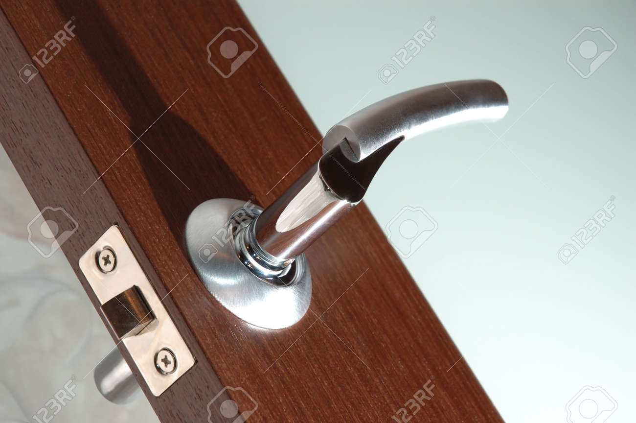 Open modern wooden glass door winh handle. Diagonal photo with direct hard light. Stock Photo - 634615
