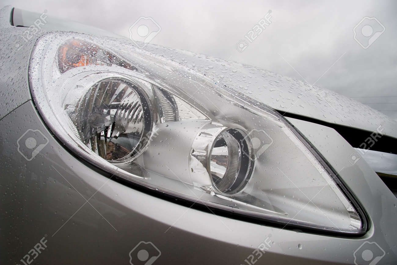 Hood of modern car after rain with drops on a headlight and body. Cloudy wheather. Stock Photo - 1254006
