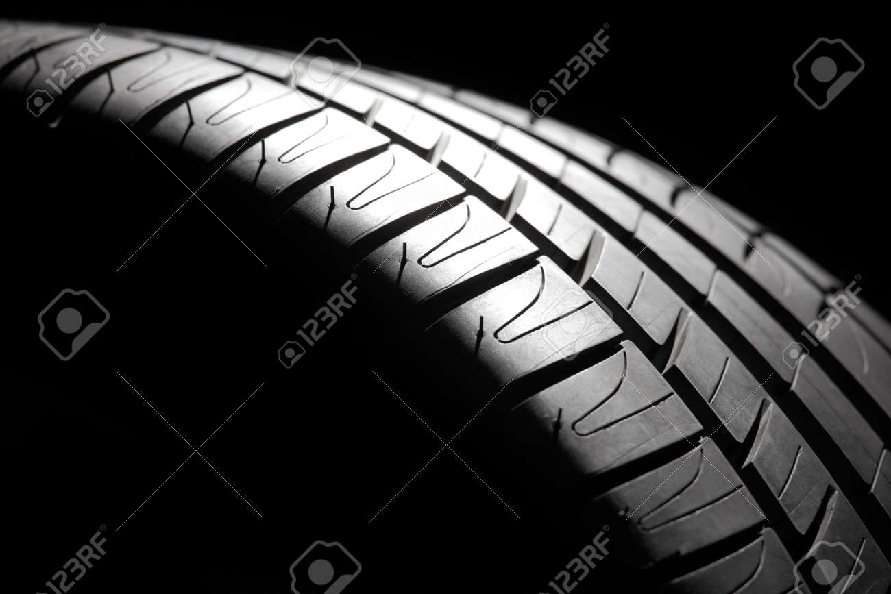 Modern high-performance sport summer tire close-up in a low key  Studio shot Stock Photo - 15110894