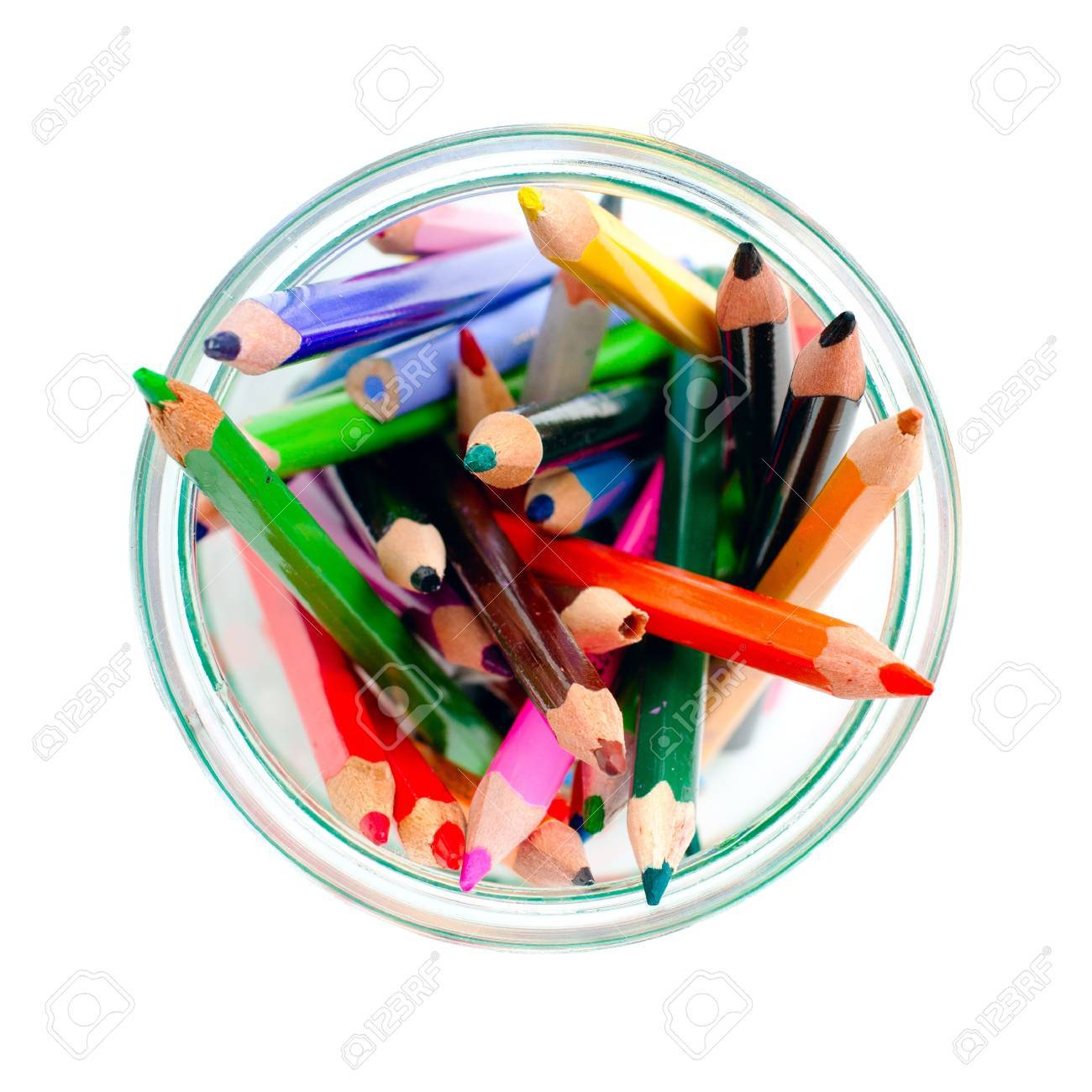 colored pencils in a clear glass jar. isolated on white Stock Photo - 12270090
