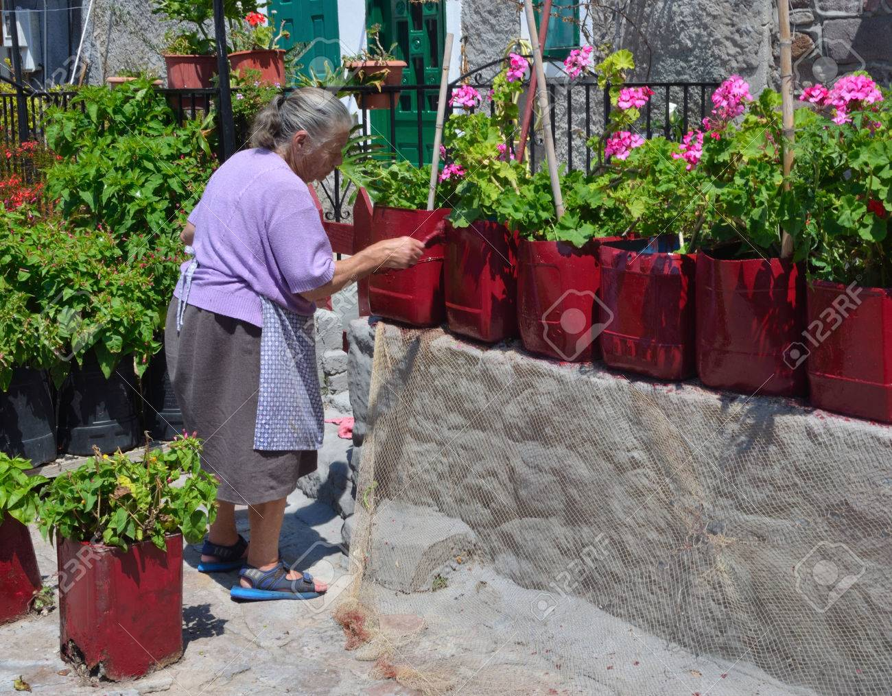 Old greek lady painting plastic plant pots. Stock Photo - 60445406 & Old Greek Lady Painting Plastic Plant Pots. Stock Photo Picture And ...
