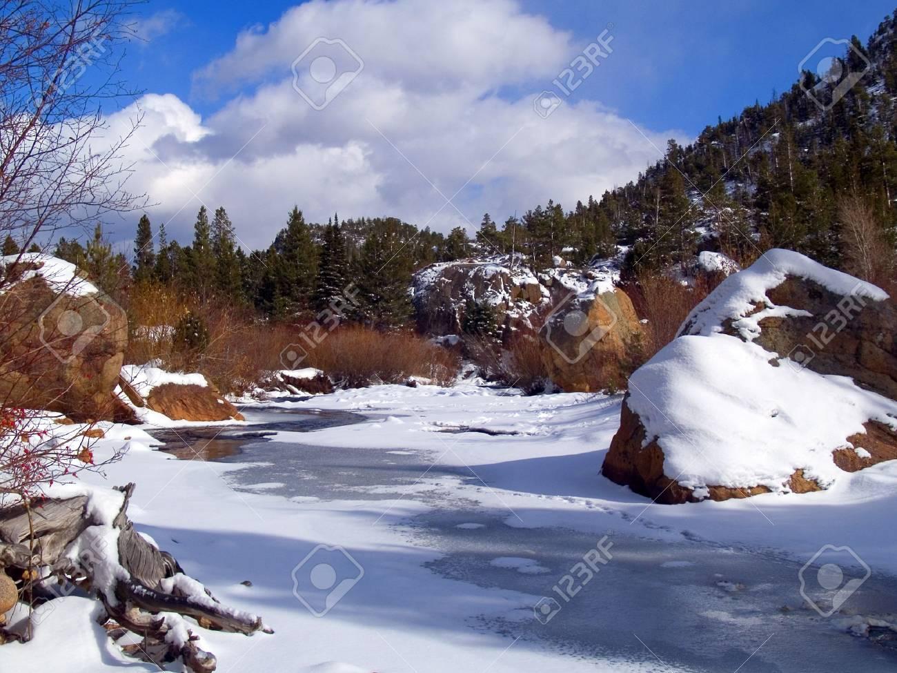 Freezing River & Blue Sky - Rocky Mountain National Park Stock Photo - 2220461