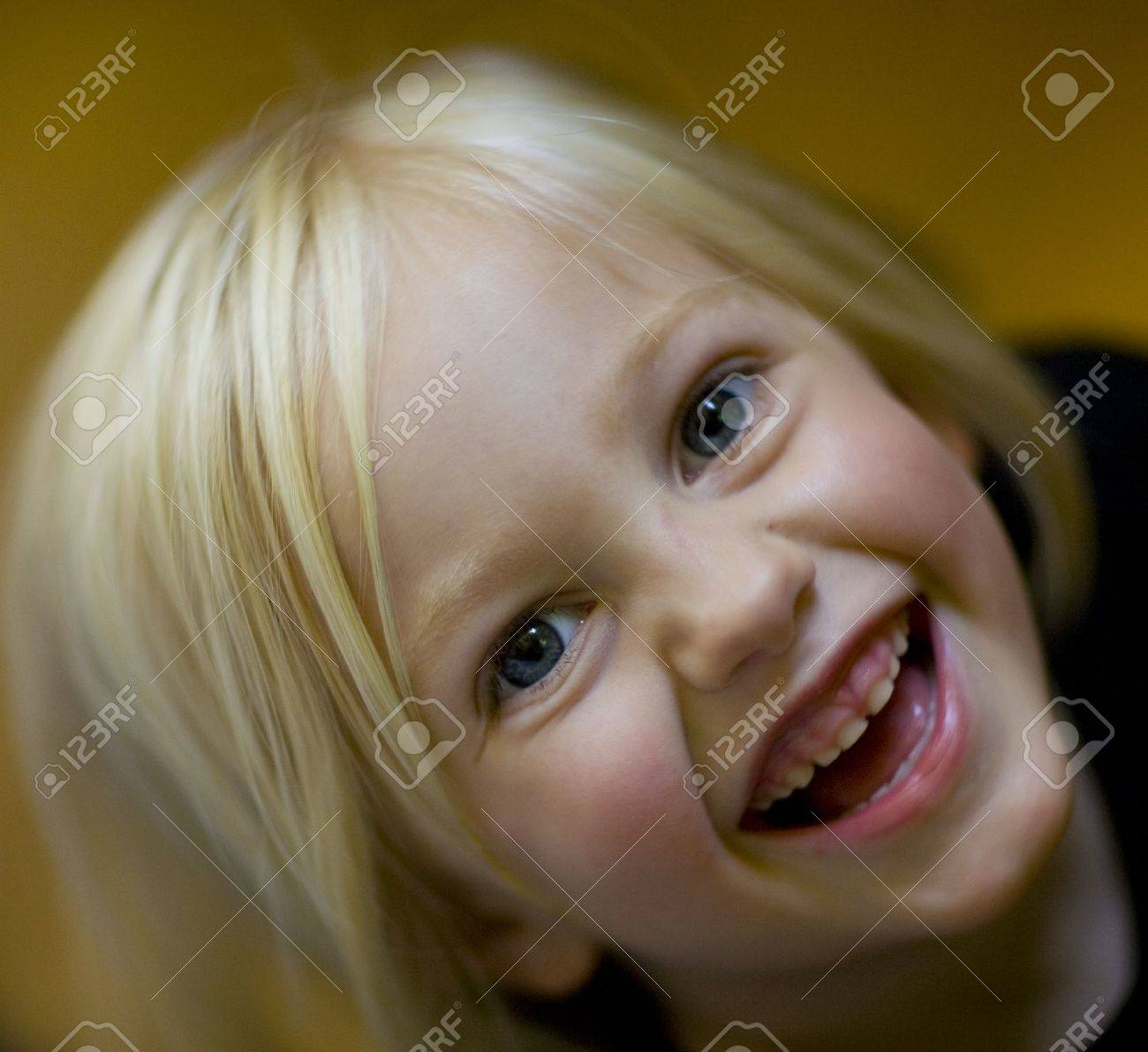 Laughing girl looking up at the camera Stock Photo - 3407728