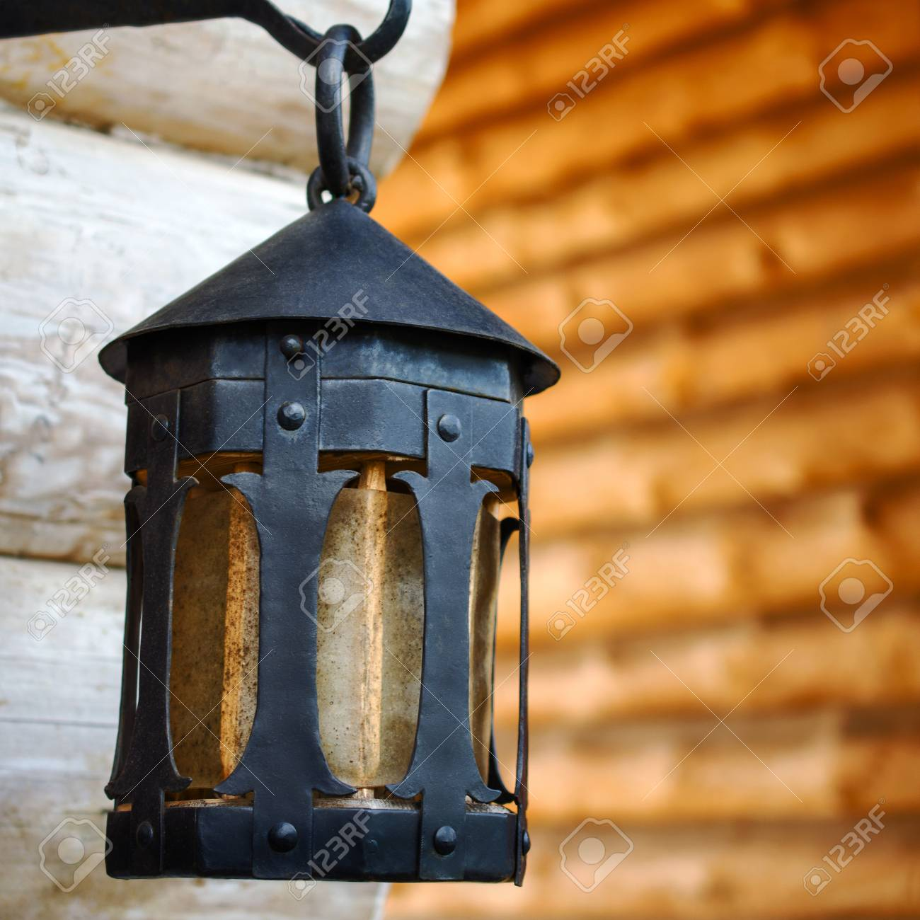 Black Decorative Antique Forged Metal Lantern On An Iron Hook Stock Photo Picture And Royalty Free Image Image 99431456