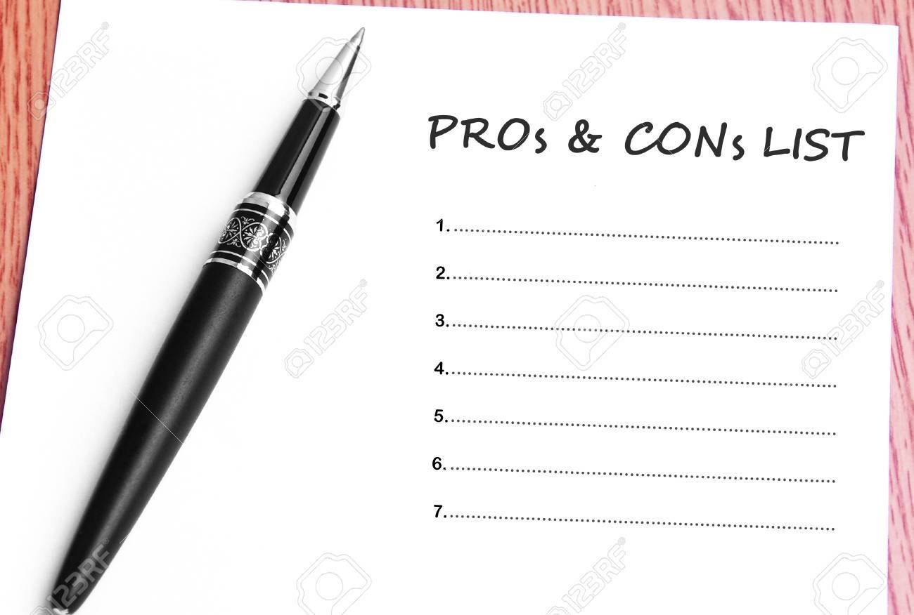 Pen And Notes Paper With Pros Cons List Stock Photo Picture And
