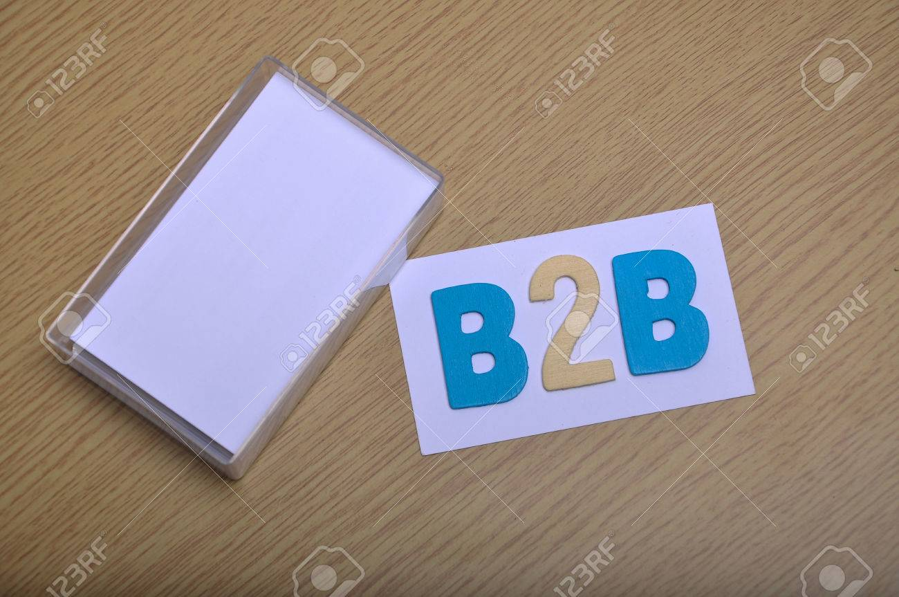 Top view flat lay blank stack of business cards in its case with stock photo top view flat lay blank stack of business cards in its case with word b2b for business to business marketing on the table copy space area to reheart Images