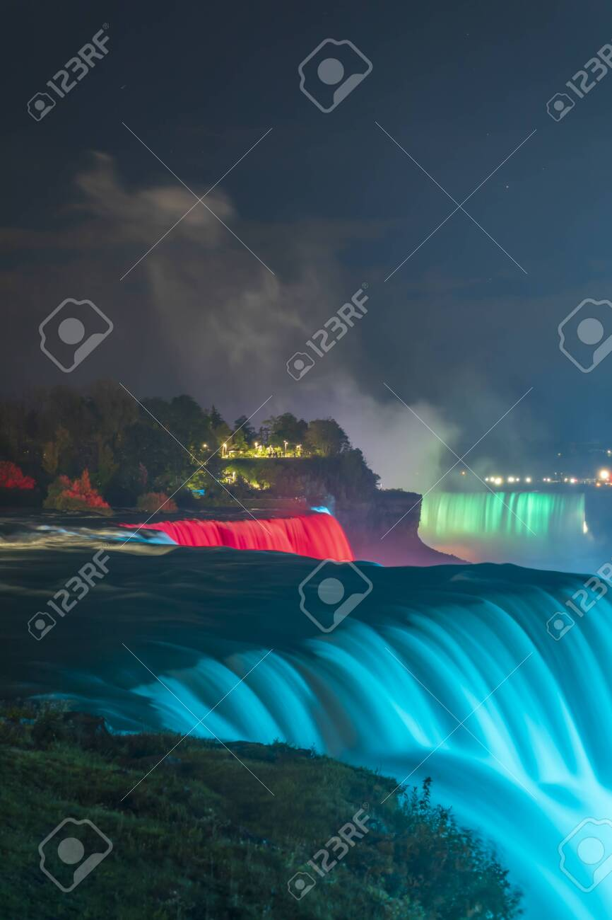 Niagara Falls - colorful illuminations of the waterfall. View from American Side - 138497513