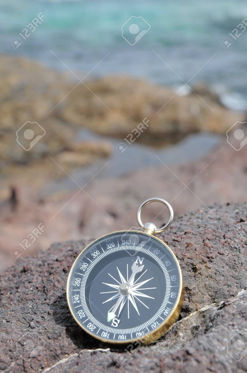One Compass on the Rocks near the Atlantic Ocean Stock Photo - 22365962