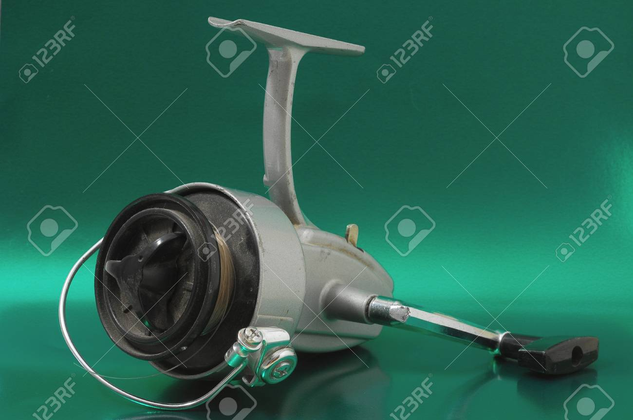 One Vintage Old Fishing Reel on a Colored Background Stock Photo - 22913114