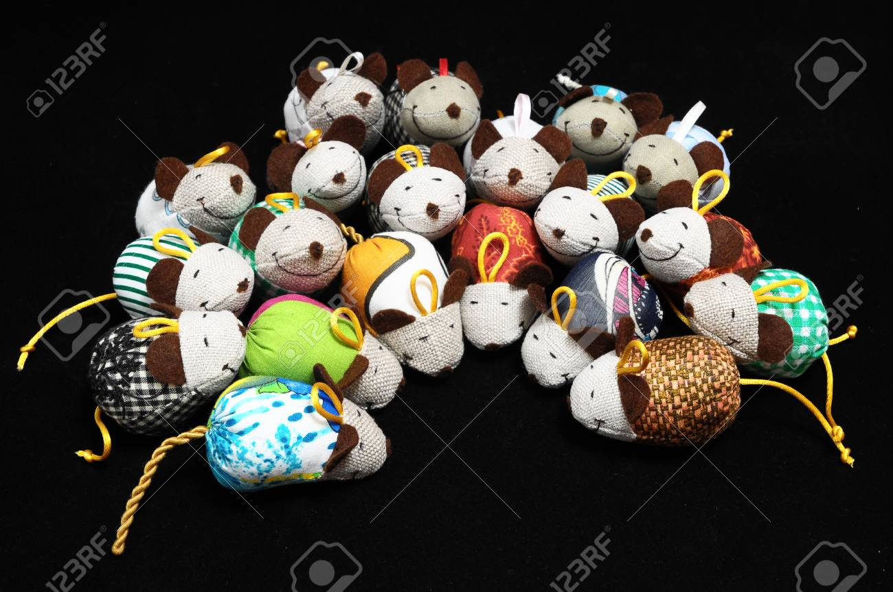 Toy Mouse Made of Cotton Cloth on a Black Background Stock Photo - 23670486