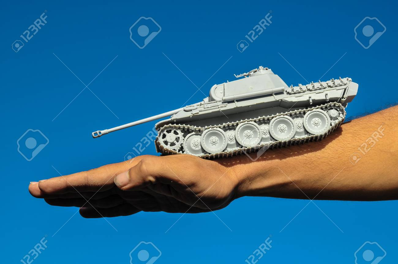Old Ancient Vinatge Figurine Model Gray Tank From World War Stock Photo - 26166166
