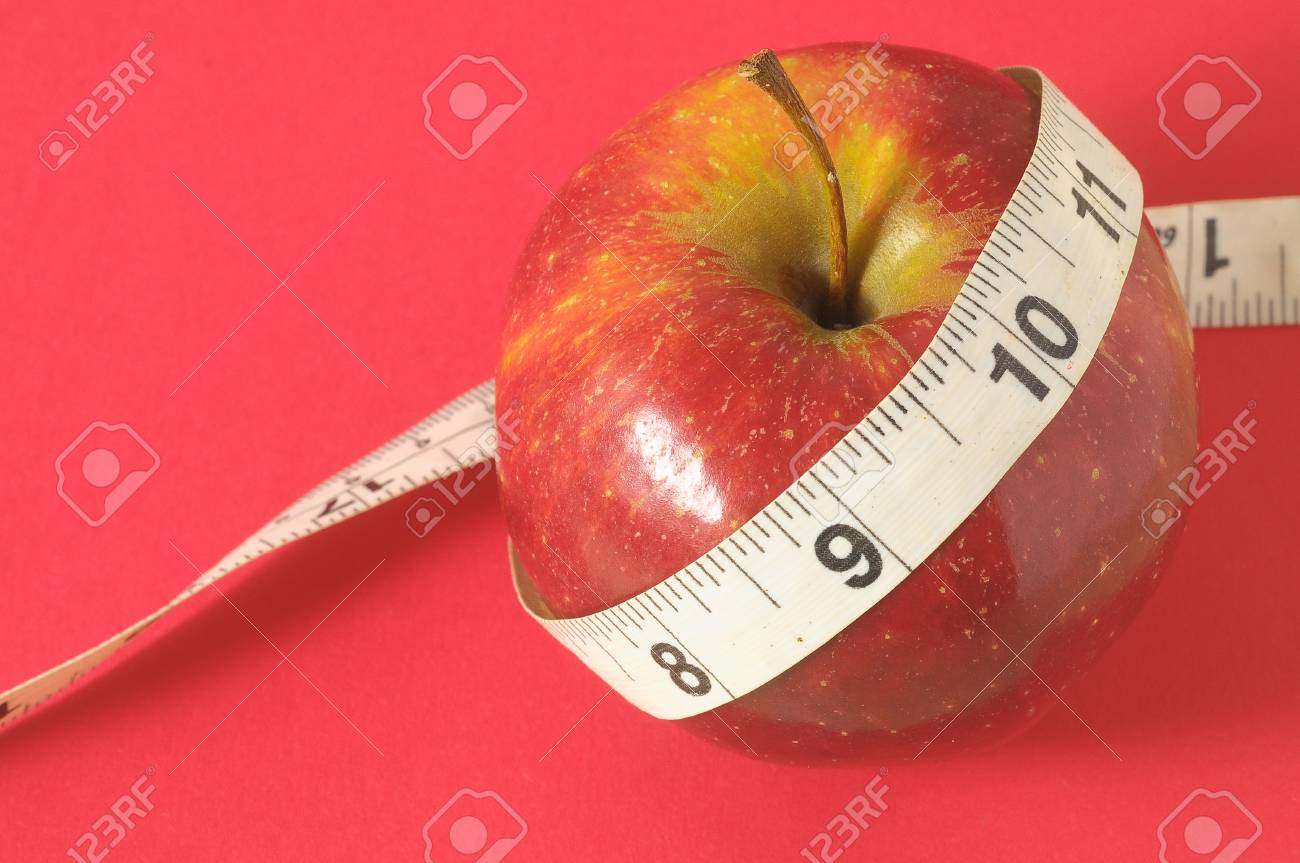 Measuring Tape Wrapped Around Red Apple As A Symbol Of Diet Stock