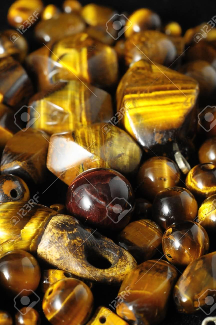 Tiger Eye Stones Ready to Make Handmade Jewelry Stock Photo - 27088989