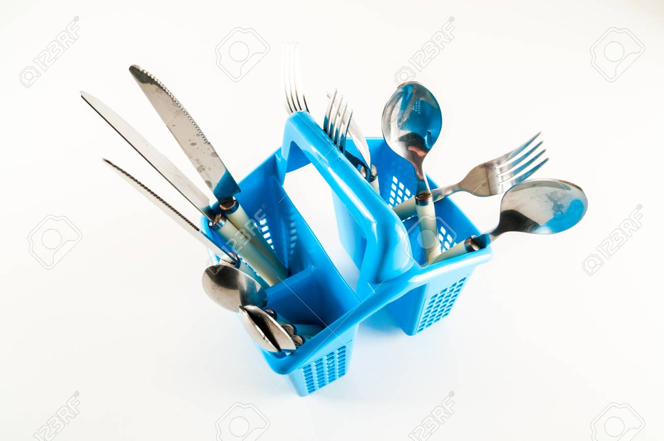 Plastic Kitchen Utensils In Cup Holder On White Background Stock ...