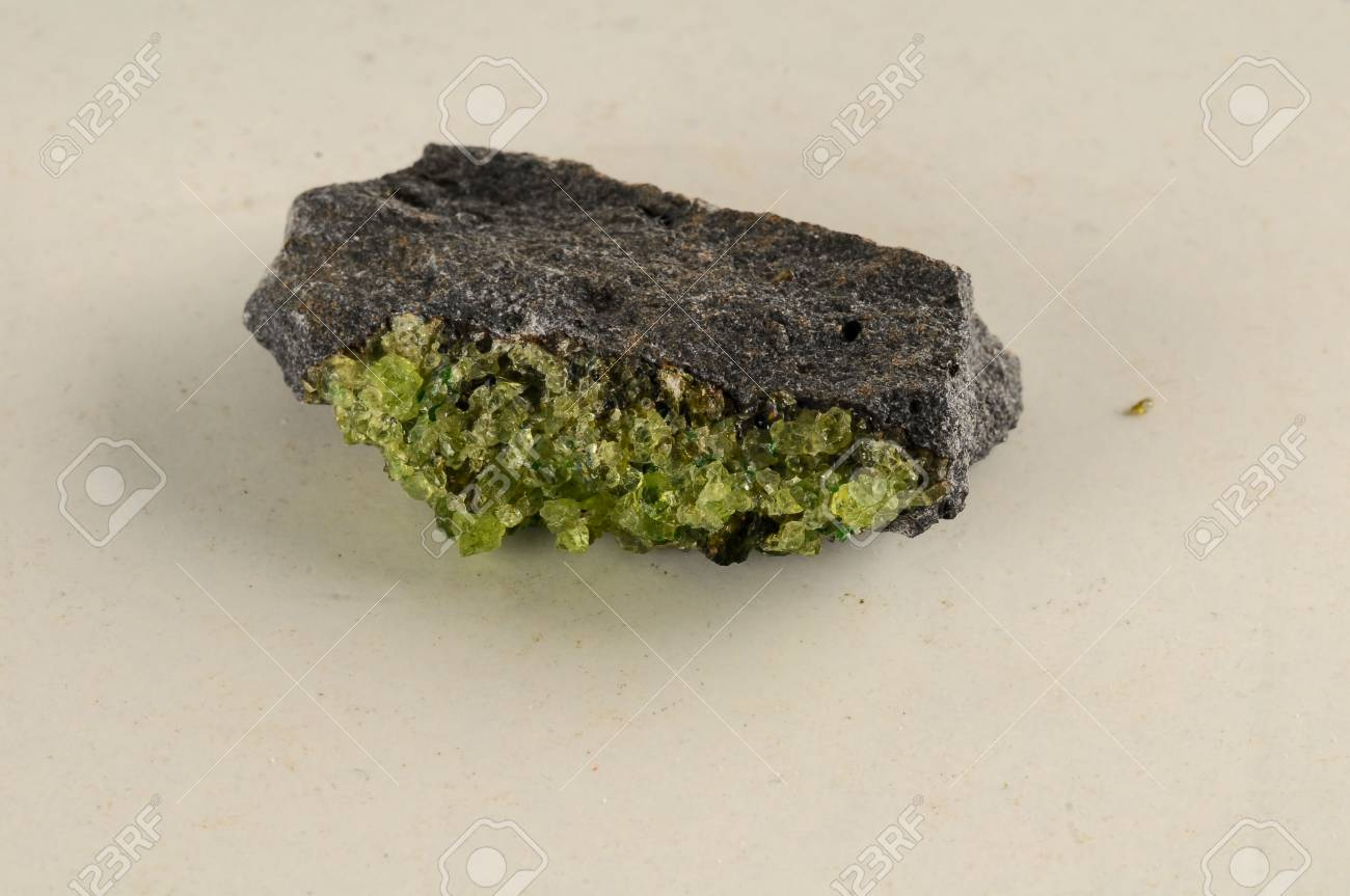 white geological on isolated peridot gemstone olivine photo mineral royalty background free natural stock chrisolite