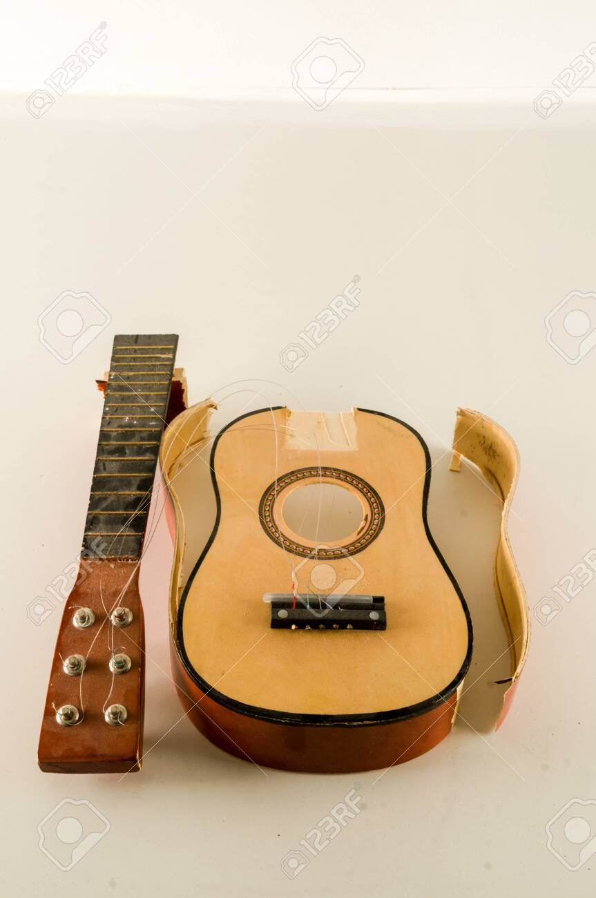 Close-up of Broken Guitar Object on a White Background - 127140402