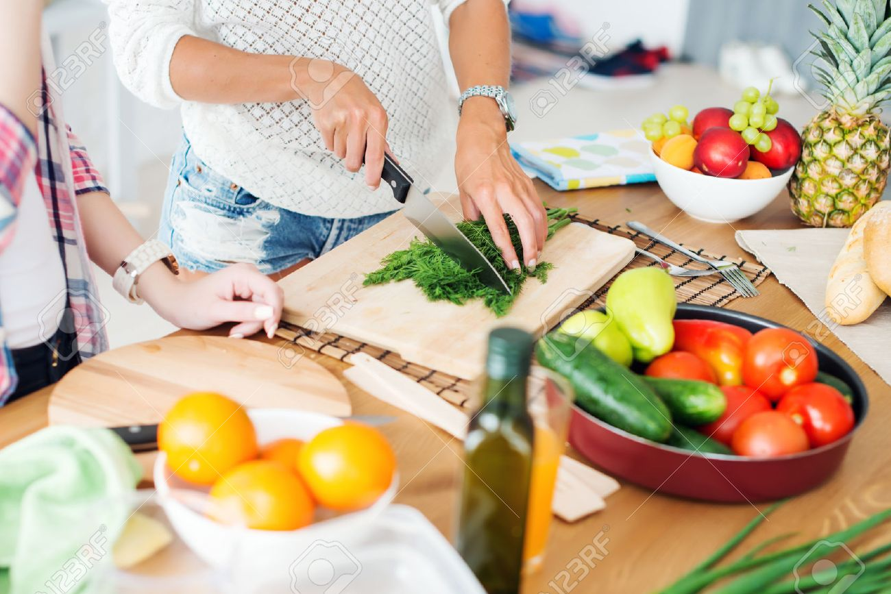 Gorgeous young Women preparing dinner in a kitchen concept cooking, culinary, healthy lifestyle Stock Photo - 43895391