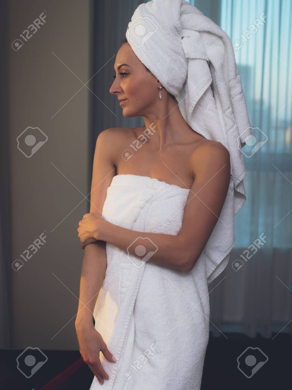 Naked woman with towel on her head and body after bath Stock Photo -  55593094