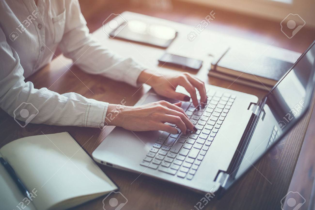 female working with laptop at home woman s hands on notebook stock