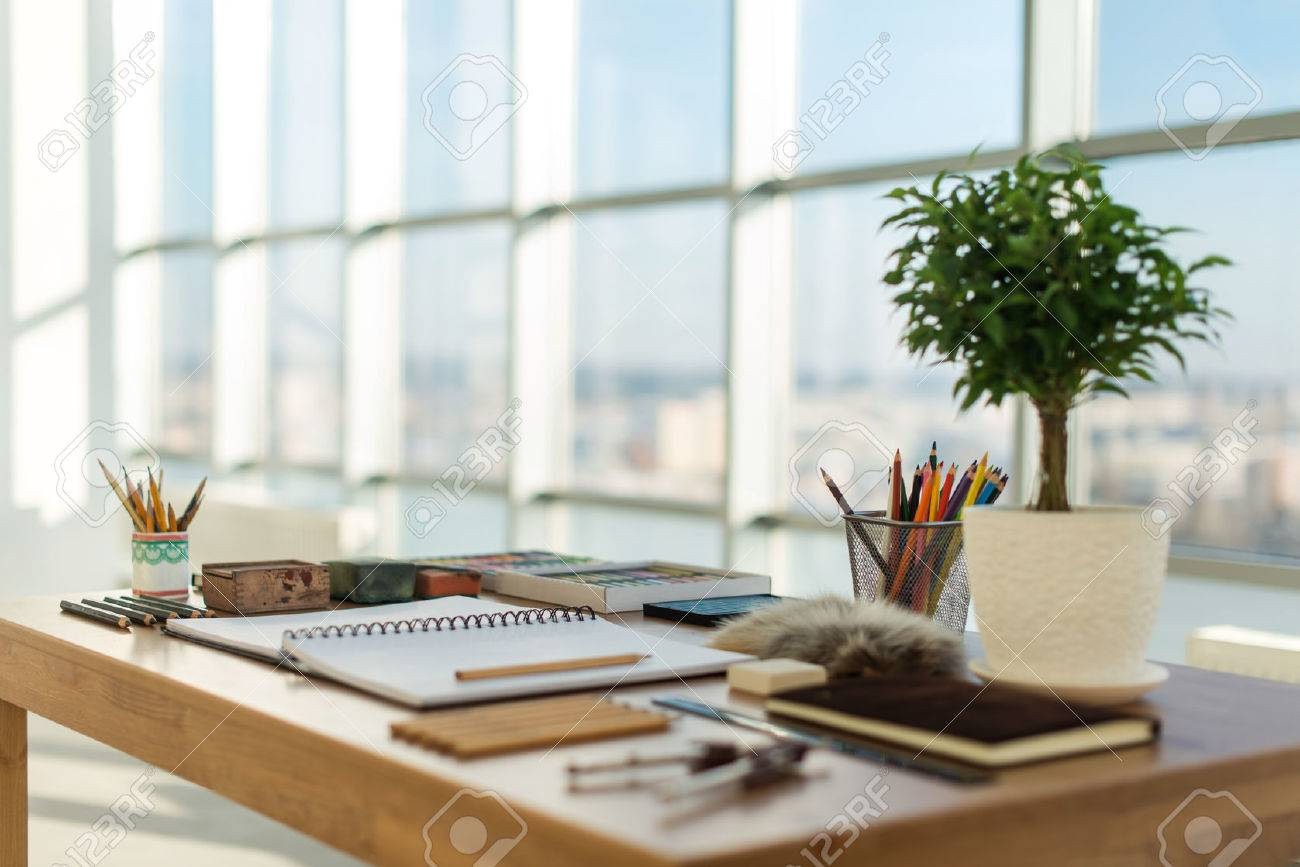 Artist workplace ready for pastel, drawing. Colorful pencils and crayons palette organized on the desktop. - 55687258
