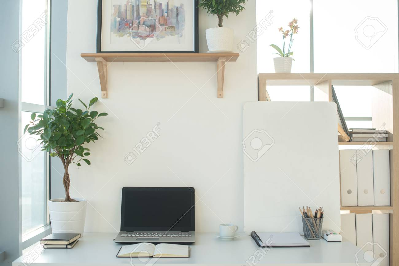 Front view picture of studio workplace with blank notebook laptop. Designer comfortable work table & Front View Picture Of Studio Workplace With Blank Notebook Laptop ...