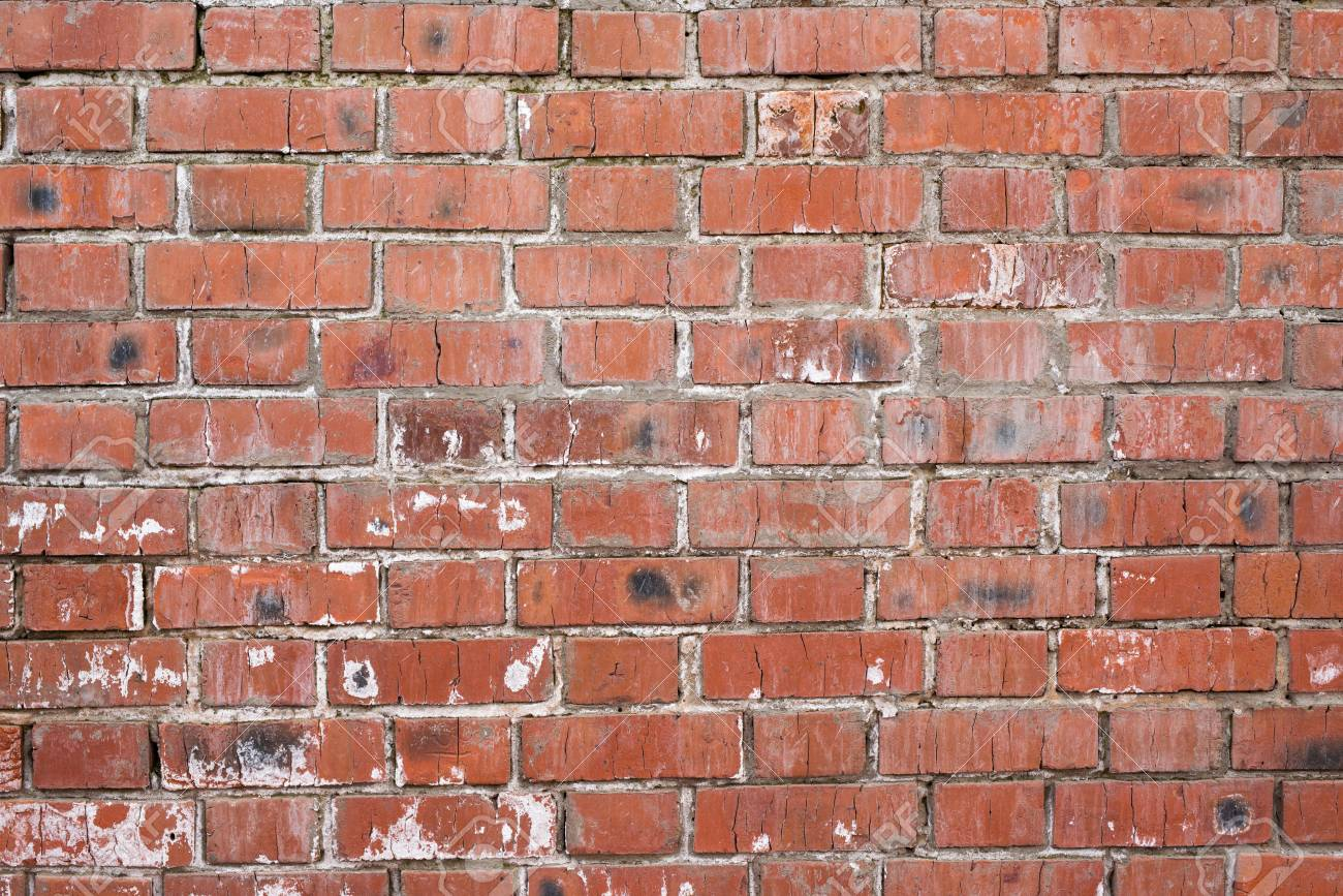 Brick wall, old texture of red stone blocks. Background. - 92769541