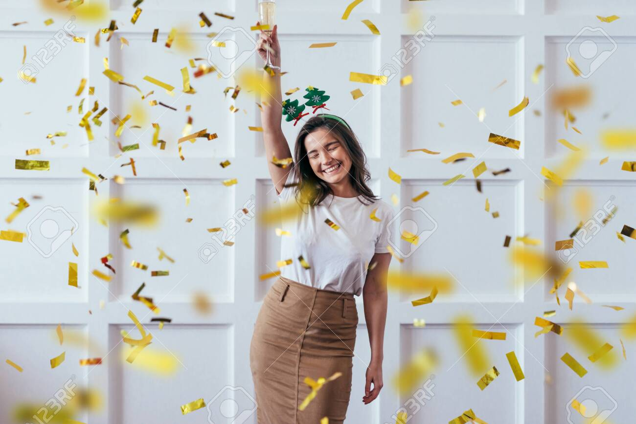 Portrait of young woman with glass celebrate Christmas or New Year - 133998167