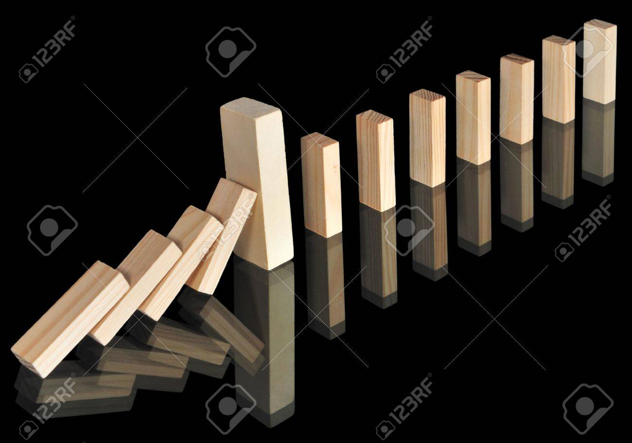 Wooden blocks with reflections isolated on black. A big massive block stops the domino effect. Stock Photo - 8152456