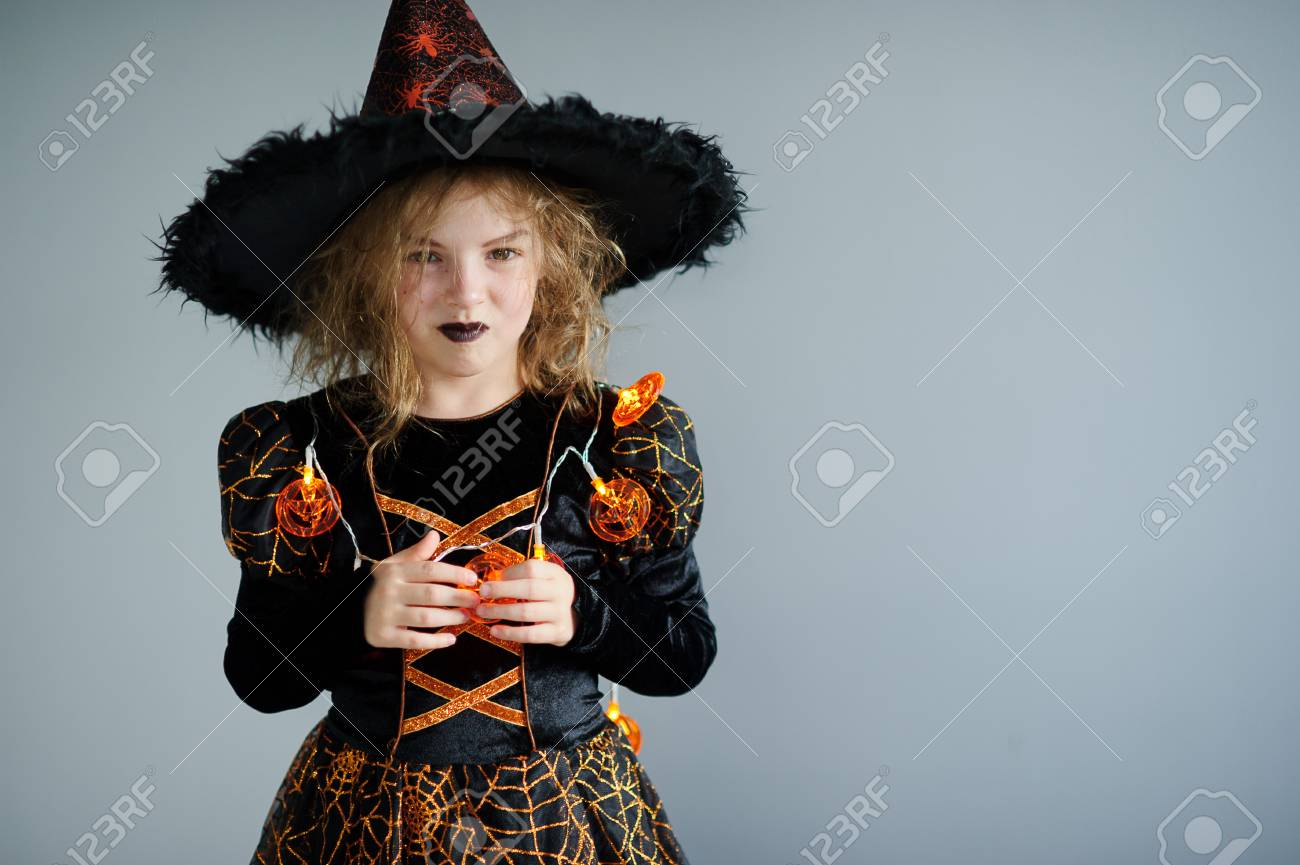 Halloween Party. Girl Shows The Evil Sorceress. She Is Wearing ...