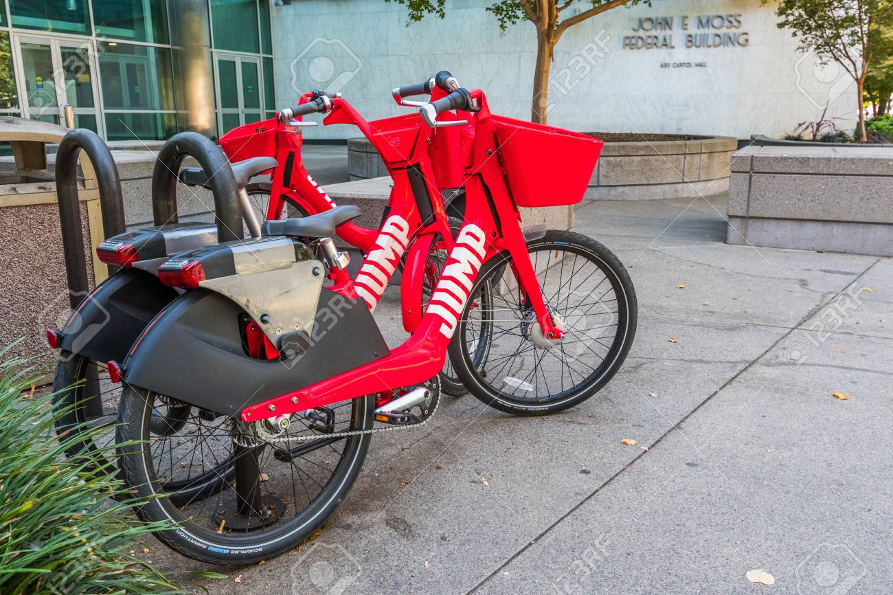 ee55c6d5b17 September 23, 2018 Sacramento / CA / USA - Jump electric bikes parked on the