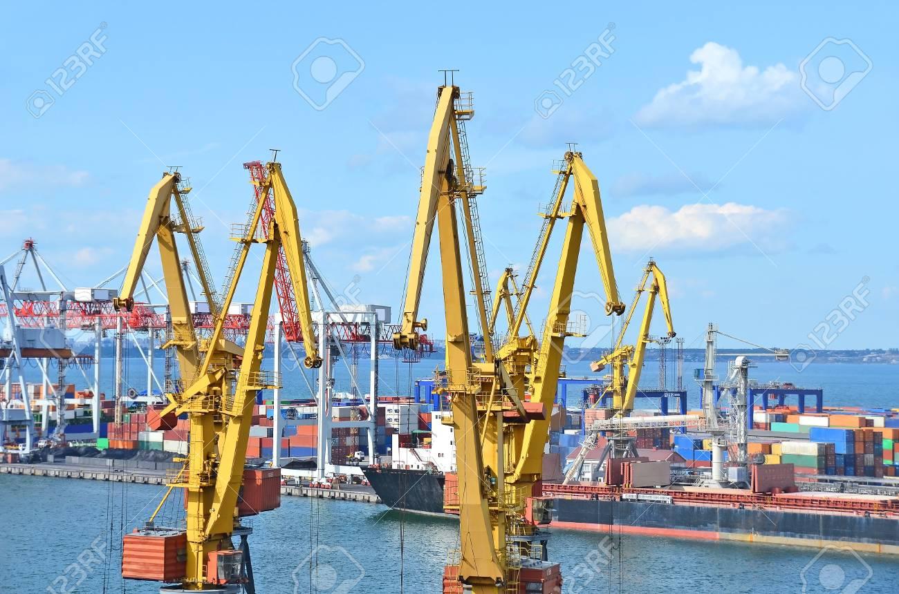 Container stack and ship under crane bridge Stock Photo - 17677308