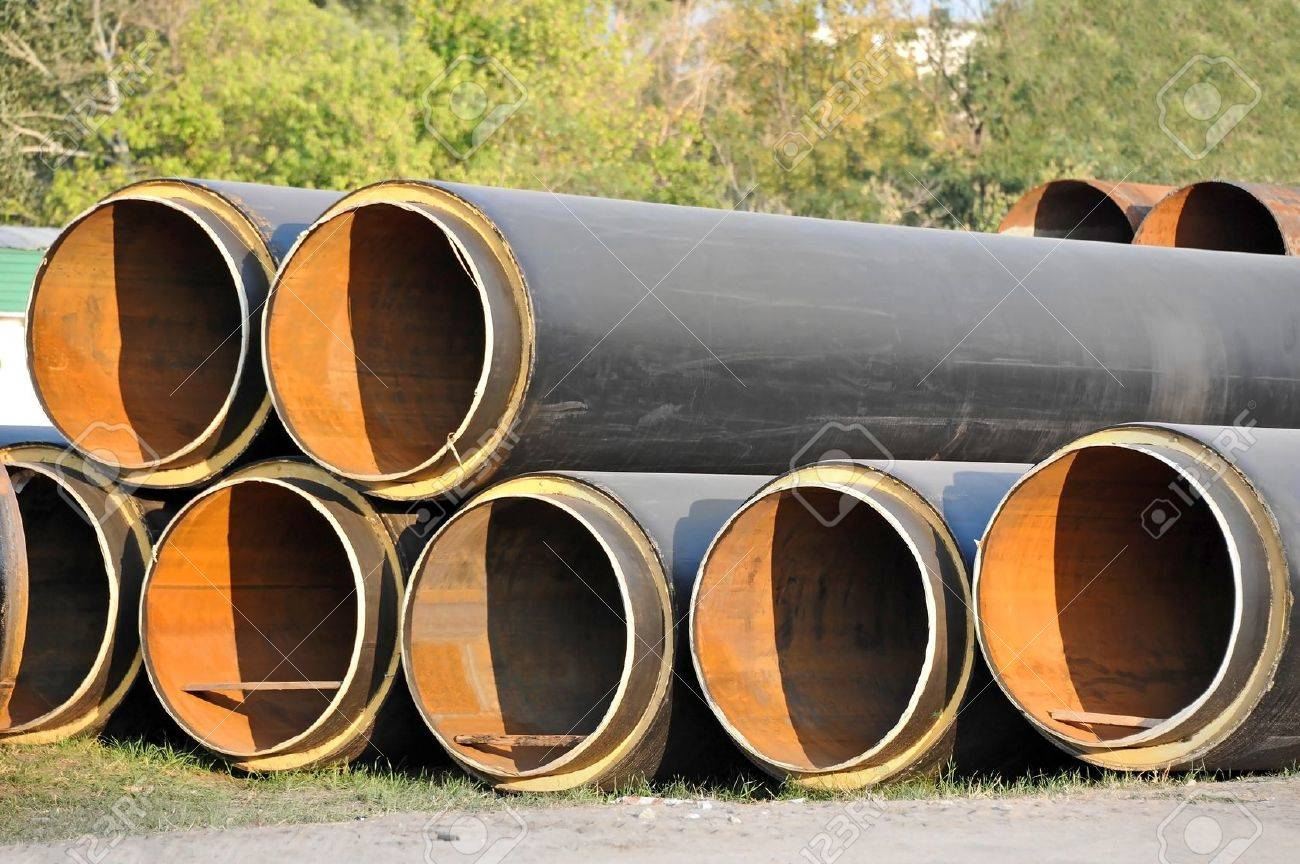 Steel pipe with heat insulation on construction site Stock Photo - 21641926